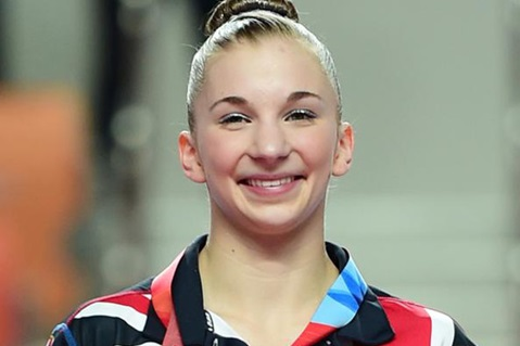 Kelly Simm Sweeps University Games Medals